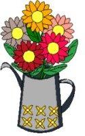 Arrosoir planté de fleurs